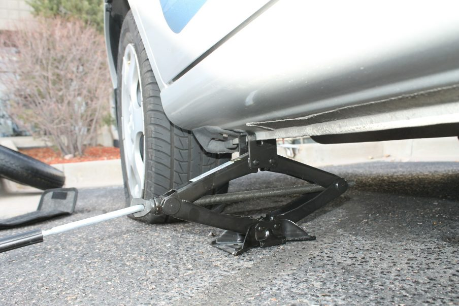 Lifting a vehicle with a car jack